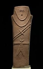 Anthropomorphic stele Arabian Peninsula. Fourth millennium B.C.E. Sandstone. Very stylized representation of a human figure, carved from stone. Has a make image and carries knives in sheaths across the chest and a knife tucked into a belt.
