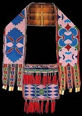 Bandolier bag  Lenape (Delaware tribe, Eastern Woodlands). c. 1850 C.E. Beadwork on leather  This is an object that invites close looking to fully appreciate the process by which colorful beads animate the bag, making a dazzling object and showcasing remarkable technical skill.