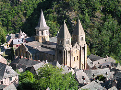 Church of Sainte-Foy Conques, France. Romanesque Europe. Church: c. 1050-1130 C.E.; Reliuary of Saint Foy: ninth century C.E.; with later additions. Stone (architecture); stone and paint (tympanum); gold, silver, gemstone, and enamel over wood (reliquary) One can see some of the most fabulous golden religious objects in France, including the very famous gold and jewel-encrusted reliquary statue of St. Foy. The Church of Saint Foy at Conques provides an excellent example of Romanesque art and architecture