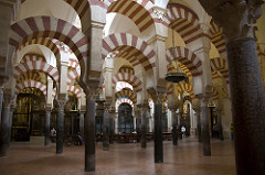 Great Mosque Córdoba, Spain. Umayyad. c. 785-786 C.E. Stone masonry The Great Mosque of Cordoba is a prime example of the Muslim world's ability to brilliantly develop architectural styles based on pre-existing regional traditions. It is built with recycled ancient Roman columns from which sprout a striking combination of two-tiered, symmetrical arches, formed of stone and red brick.