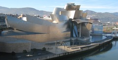 Guggenheim Museum Bilbao Spain. Frank Gehry (architect). 1997 C.E. Titanium, glass, and limestone.  A museum to challenge assumptions about art museum collecting and programming with its inventive design. To showcase great fine art exhibitions and further the redevelopment of the city Bilbao.
