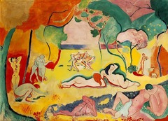 Henri Matisse, The Joy of Life, 1905, Fauvism • Large unmodualted areas of color • Arbitrary use of color, not used to describe empirical experience but an expression of the artist • Interest in the primitive and the beginnings of time and culture, the most natural human being, the most emotional and real • Color is a response to emotional expression and the formal needs of the canvas • Constructs the landscape so that it functions as a stage, like Cezanne • Like Cezanne, Matisse unifies the figures and the landscape • The curvilinear poses of the women echo the movement of the trees  • Wildly sensual figures, remind of Ungre's odalisques and harem fantasies/ exoticism  • No use of perspective at all, the sale is badly skewed • Cezanne ruptured form to accurately explore vision as experienced through time and space, forms look different depending on where we are in relation to them, collapses time and space • Shifting perspectives is the result of changing position