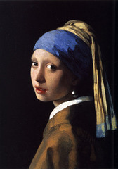 Jan Vermeer The Girl with the Pearl Earring 1665 Dutch Baroque  • His virtuosity of painting young women is seen here  • He is the treasure of the more realist Durch Baroque Style of Protestant reformation Art (less opulent than Rubens)  • The compsiition is simple, the subject is only a simple head of a girl looking over her shoulder at the viewer • No hint of setting is provided, other than its atmospherical dark tone  • The direct contact between subject and spectator, and the slightly parted position of her lips, present a sense of intimacy  • Contrasts: simple brownish-yellow top next to bright white collar  • The blue yellow turban, gives an exotic effect • Turbans were common accessory in 15th century (Man with Red turban Jan Van Eyck)  • The enomrmous pearl earing, women should protect their ears from unclean words, that they should only hear chaste word- the