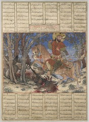 Title/ Designation: Bahram Gur Fights the Karg Artist/ Culture: folio from the Great Il-Khanid Shahnama, Islamic, Persian, Il'Khanid Date of Creation: c. 1330-1340 CE Materials: ink and opaque watercolor, gold, silver on paper