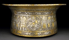 Title/ Designation: Basin (Baptistére de St. Louis) Artist/ Culture: Muhammad ibn al-Zain Date of Creation: c. 1320-1340 CE Materials: brass inlaid with gold and silver
