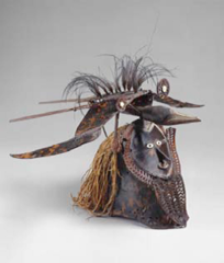Title/ Designation: Buk (mask) Artist/ Culture: Torres Straight  Date of Creation: Mid-to late 19th century CE Materials: Turtle shell, wood, fiber, feather, and shell