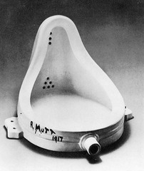 Title/ Designation: Fountain (second version)  Artist/ Culture: Marcel Duchamp Date of Creation: 1950 CE (original 1917) Materials: readymade glazed sanitary china with black paint