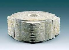 Title/ Designation: Jade Cong Artist/Culture: Liangzhu, China Date of Creation: 3,300-2,200 BCE  Materials: Carved Jade