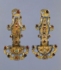 Title/ Designation: Merovingian looped fibulae Artist/ Culture: Early medieval Europe Date of Creation: mid-century CE Materials:silver gilt worked in filigree, with inlays of garnets and other stones