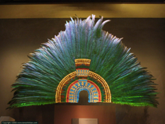 Title/ Designation: Ruler's feather headdress (probably of Moctecuhzoma II)  Artist/ Culture: Mexica (Aztec) Date of Creation: 1428-1520 CE Materials: feathers (quetzal and cotinga) and gold