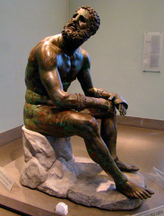 Title/ Designation: Seated boxer Artist/ Culture: Hellenistic Greek Date of Creation: c. 100 B.C.E. Materials: Bronze