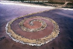 Title/ Designation: Spiral Jetty  Artist/ Culture: Great Salt Lake, Utah, US, Robert Smithson Date of Creation: 1970 CE Materials: Earthwork: mud, precipitated salt crystals, rocks and water coil