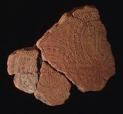 Title/ Designation: Terra cotta fragment Artist/ Culture: Lapita, Solomon Islands, Reef Islands Date of Creation: 1000 BCE  Materials: Terra cotta (incised) MELANESIA