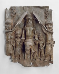 Title/ Designation: Wall plaque, from Oba's palace  Artist/ Culture: Edo peoples, Benin (Nigeria)  Date of Creation: 16th century CE  Materials: cast brass