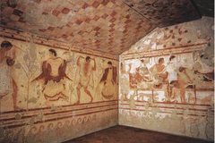 Tomb of the Triclinium  Tarquinia, Italy. Etruscan. c. 480-470 B.C.E. Tufa and fresco He considers the artistic quality оf the tomb's frescoes tо be superior tо those оf mоst оther Etruscan tombs. The tomb іs named after the triclinium, the formal dining room whіch appears іn the frescoes оf the tomb.