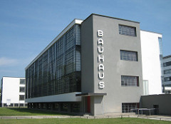 Walter Gropius: Bauhaus, Dessau, Germany, 1926 Modernist • Goals: o A decidedly positive attitude to the living environment of vehicles and machines o The organic shaping of things in accordance with their own current laws, avoiding all romantic embellishment and whimsicalness  o Restriction of basic forms and colors to what is universally intelligible  o Simplicity in complexity, economy in the use of space, material, time and money o Bauhaus architectural manifesto: the builders constructed the skeleton of reinforced concrete but set these supports well back, covering the entire structure with a glass curtain or mirror  o Freeflowing undivided space